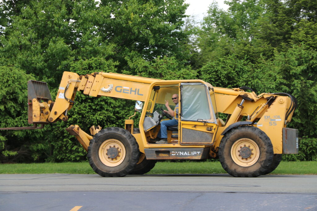 Mike Watkins operating a large construction vehicle